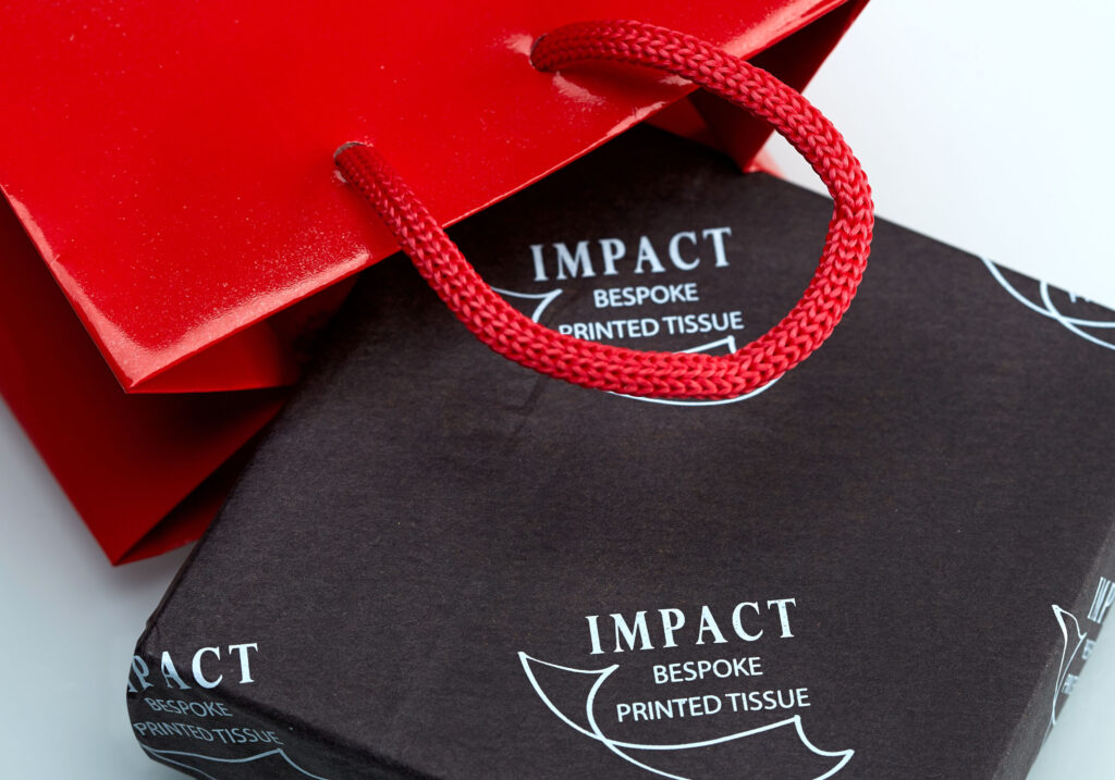 Red bag on bespoke printed tissue paper